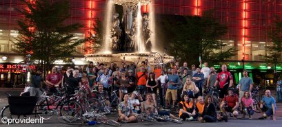 group of cyclists in front of Fountain Square