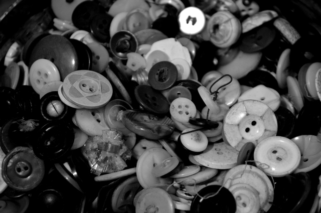 three tins of buttons exist, collected over decades and decades from coats, dresses, skirts, and shirts of relatives.